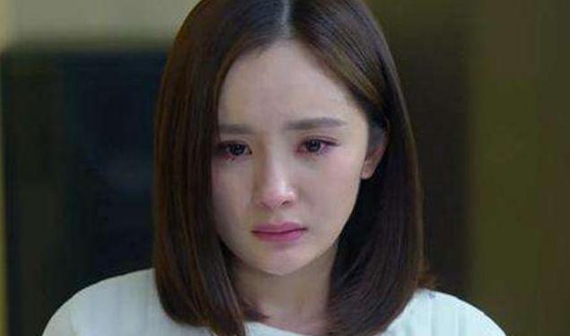 女人伤心绝望流泪的图片_WWW.QQYA.COM